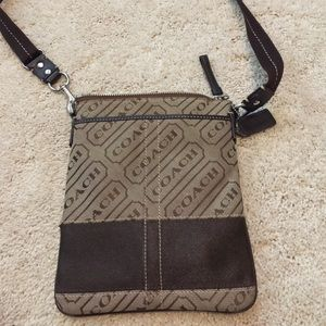 Brown coach cross body purse with pockets